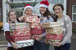 : Student nurses at Wrexham Maelor hospital delivering Christmas gifts to patients on the Bedwen and Onnen long stay rehab wards. Pictured are Fern Williams,  Lecturer Angela Williams, Ceri Davies and Kate Topple.