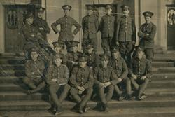 Men of the Officer's Training Corps on the steps of PJ Hall: One of the first institutions of the College, the Corps at Bangor was attached to the Royal Garrison Artillery, with Principal Sir. Harry R. Reichel as Captain.