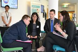 Three of the winning FLUX team -from left: ZhiHong Zhao, Daniel Taylor and Kate Ishwerwood, discsussing with James Johnston from Costain Ltd during one of the competition mentor meetings.