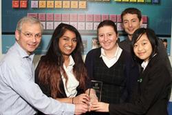 (l-r) Caitlin Pierce, Elin Wynne and Alice Ma, being presented by Dr Mike Becket, head of Bangor University's School of Chemistry, with their teacher Mark Hannat,  a Bangor University Chemistry graduate.