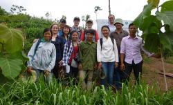 The team visiting an on-farm agroforestry demonstration plot of teak, coffee, plum, and strips of fodder grass, in Mai Son District, Northwest Vietnam.