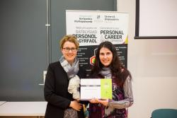 Alex receives her award from Professor Carol Tully, Pro-Vice Chancellor (Students)
