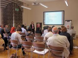 Ms. Evelyne Schmid presenting