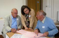Professor Linton and two workshop attendees in animated discussion.