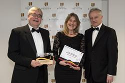 Professor Peredur Lynch and Mari Watkin of WJEC/CBAC receive their awward from Professor John Hughes.