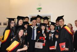 Some of this year's graduates with Professor John Goddard, Deputy Head of School