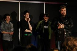 Comdey Society members performing with comedian, Phil Jupitus last year.