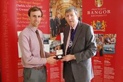 Ben Butler (left) being presented with the Drapers' Medal by John Giffard, Master Draper.