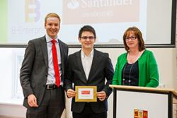 Bogdan Pop (centre) receiving his Santander Universities Excellence in Enterprise Award from Luke Ellis, Relationship Director at Santander Universities, and Lowri Owen, Enterprise Projects Manager