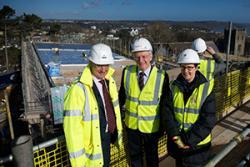 Peter Dodd, Senior Project Manager, Vinci Construction UK Ltd. with Professor John G Hughes Bangor University Vice Chancellor and Professor Carol Tully Pro Vice-Chancellor (Students).