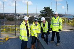 Left- right are Mark McNamee, Managing Director, Cityheart Ltd.; Peter Dodd, Senior Project Manager, Vinci Construction UK Ltd. with Professor John G Hughes, Vice Chancellor conducting the 'topping out' and John Roberts, Vinci Construction UK.