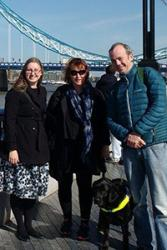 :  Transforming Young Lives report authors (centre) Professor Rhiannon Tudor Edwards and guide dog Jazz, (left) Lucy Bryning and (right) Huw Lloyd Williams of Bangor University