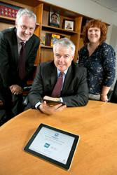 Dr Dewi Bryn Jones and Delyth Prys assist First Minister Carwyn Jones to record his voice for the Speech Recognition resource.