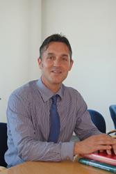 Dr Carl Hughes