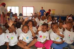 Young children at the Early Learning Centre, Mafikeng make, and show-off, new t-shirts, the t-shirts will now be the school uniform every Wednesday.