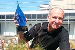 Professor Chris Freeman with his recent award as a Fellow of the Society of Wetland Scientists – recognising him as one of the world's leading experts on wetlands