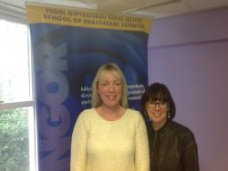 Clare Woodcock (left) pictured here with Prof Jo Rycroft Malone, Head of School of Healthcare Sciences
