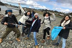 Portuguese student Ruth Gabriella Fernandes, in the middle, during Cricieth's Beach Clean