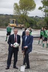 (left) Bangor University Vice-Chancellor, Professor John G Hughes and Bangor City FC Chairman, Dilwyn Jones, with University student Football Team members checking out the site of the new 3G pitch at Nantporth