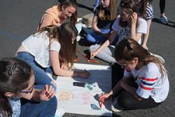 Year 8 pupils at Ysgol Dyffryn Ogwen, Bethesda create a poster outlining what they see as the economic, social, environmental and cultural benefits of community energy.