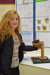 Year 12 pupil of Ysgol Eirias displays her designed lamp