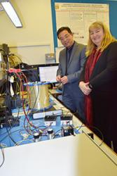 Professor Tang explains the high-tech equipment at his lab to the Minister.