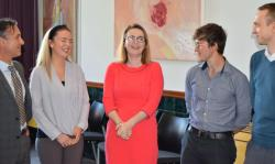 Education Minister, Kirsty Williams, with staff and students from the School of Education and Human Development