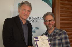 PVC Prof Jerry Hunter (left) presenting Prof Nathan Abrams with his certificate