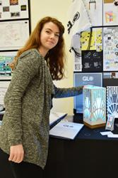 Carys Matthews of Ysgol y Creuddyn makes last minute adjustments to her work at the Exhibition