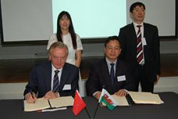 Prof John G Hughes and Prof Xianyan Zhou sign the agreements with Dr Xinyu Wu, Director of International Development, Bangor & Prof Zhuqing Yang, Dean of Bangor College, China.