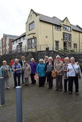 The group enjoy a guided tour around the newly re-designed site, which retains some familiar buildings and names.