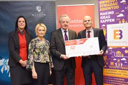 Santander competition judges Diane Roberts, Dr Siwan Mitchelmore and Prof John G Hughes present a cheque to Dr Ned Hartfiel. Ha