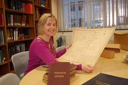 Archivist Elen Simpson with some of the papers from the Penrhyn Estate collection.
