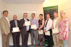 Coleg Cambria had the largest number of teachers and lecturers on this Sabbatical course. Being congratulated by Prof Jerry Hunter are: Alan Williams, Dylan Rhys Jones, Sally O'Garra, Dennis Evans and Andrew Cordiner, with Eleri Hughes, course tutor.