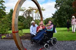 Dr Sophie Williams with Shaun Russell (Director) and Natalie Chivers (Curator) of the Treborth Botanic Garden, Bangor University, after cutting the ribbon at the Moongate entrance to the new Chinese Garden.