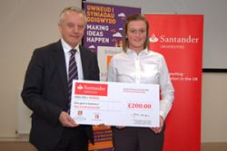 Carley Williams receives hes prize from Bangor University Vice Chancellor, Professor John G Hughes.