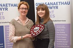 While all the Peer Guides at Bangor University were thanked, Victoria Fennel was awarded Peer Guide of the Year. here she is presented with a shield by Vice Chancellor Prof Carol Tully.