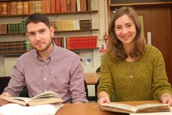 Elen Wyn and Siôn Edwards busy researching in the University's Archive