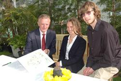 Second year Applied Terrestrial & Marine Ecology student Sam Herniman and lecturer, Sophie Williams, show Vice-Chancellor Prof John Hughes the garden Sam designed as an internship under the 'Bangor Employability Award'.