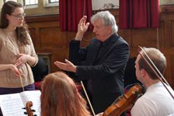Catherine Linney receiving advice and feedback from Conductor, Owain Arwel Hughes.