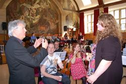 Francesca Reader listens to valuable feedback on her conducting from Owain Arwel Hughes.