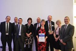 The Beacon team receiving the Award with Minister Jane Hutt at the event in Brussels.
