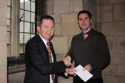 Professor Oliver Turnbull (left) presenting David with the £1,000 cheque.