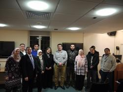 Some of the Iraqi students with Professor Linton after Sinan and Nidham's presentation