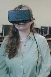 Delwen De Jong, Bangor University RSC Co-Ordinator, trying the Oculus Rift