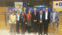 Delyth Prys (4th from left) and Dewi Bryn Jones (right) at the European Parliament with Jill Evans MEP (centre)