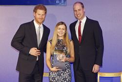 Elan Gilford with TRH Prince Harry and the Duke of Cambridge.
