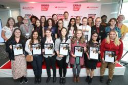 Ellie Frost ( third from right front row) at Silverstone with the other successful engineering students.