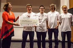 Paola Dyboski-Bryant from Dr Zigs Extraordinary Bubbles presents a cheque to winners, Team Crocus, who are:(l -r) Sam James, Bogdan Pop, Jordan Burns and Rory Robson.