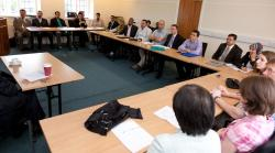 Students and staff listen intently to Professor Ala Hamoudi